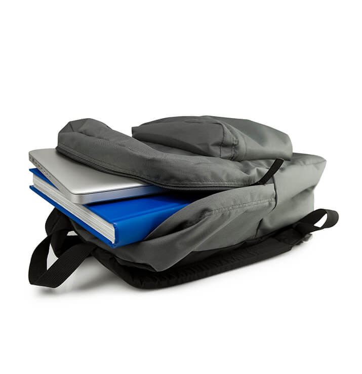 Backpack with books and laptop
