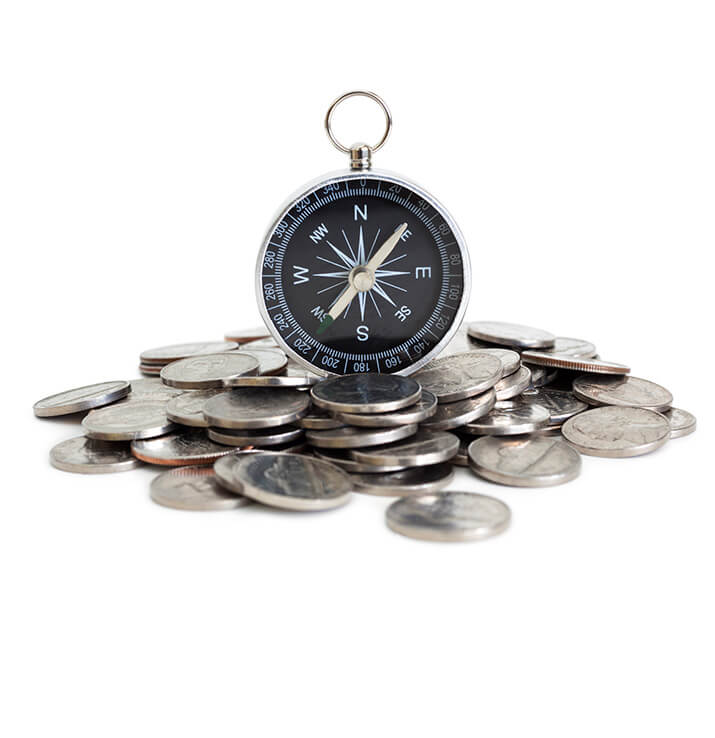 A compass on top of coins