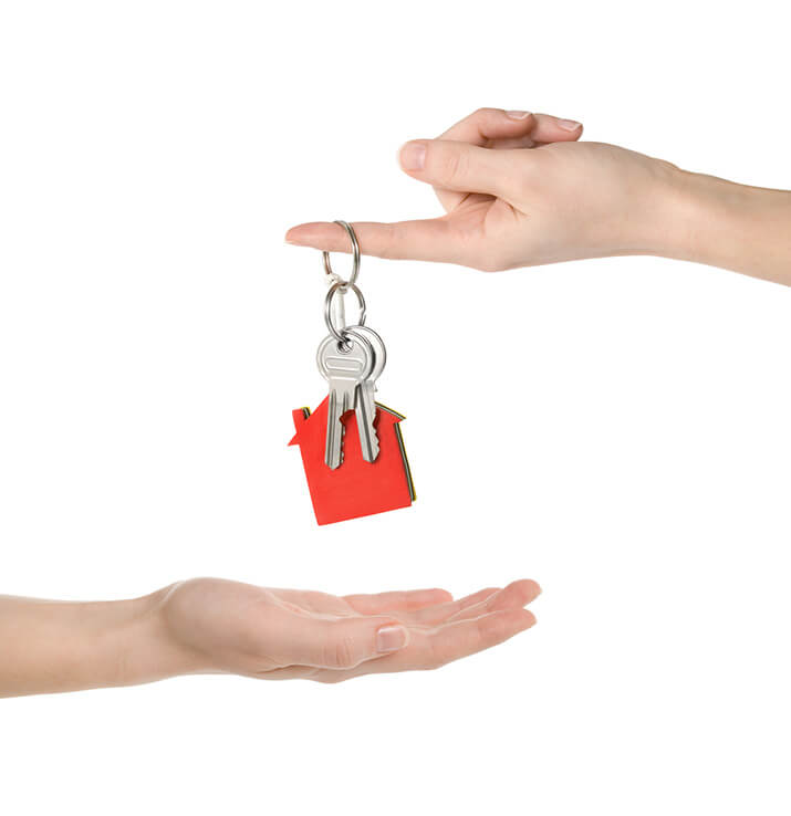Two hands, exchanging keys