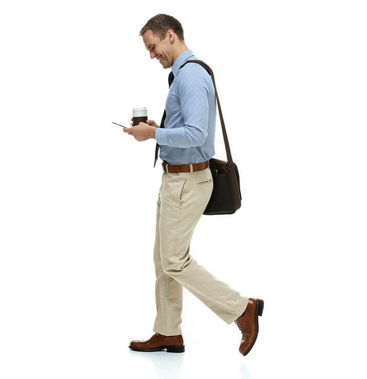Man walking with coffee and phone