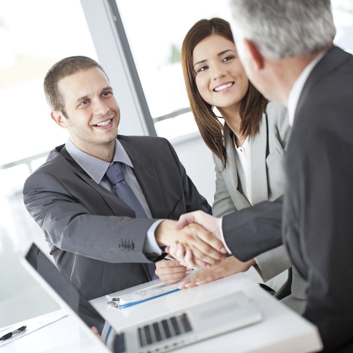 men shaking hands during meeting